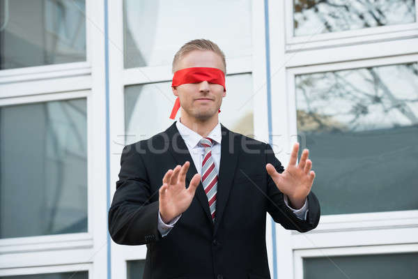 Blindfolded Businessman Standing Against Window Stock photo © AndreyPopov
