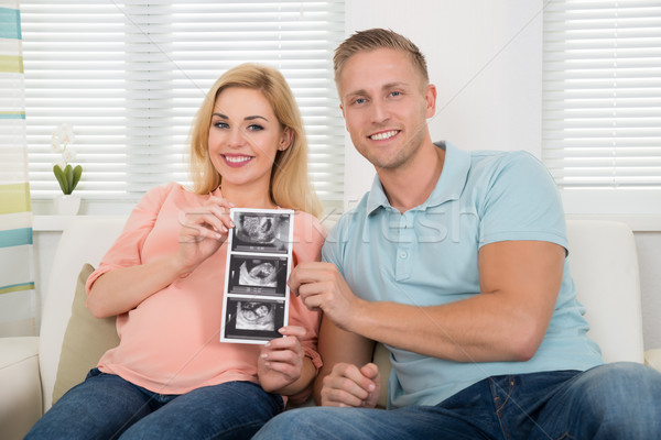 Happy Expectant Couple Showing Ultrasound Scan Report At Home Stock photo © AndreyPopov