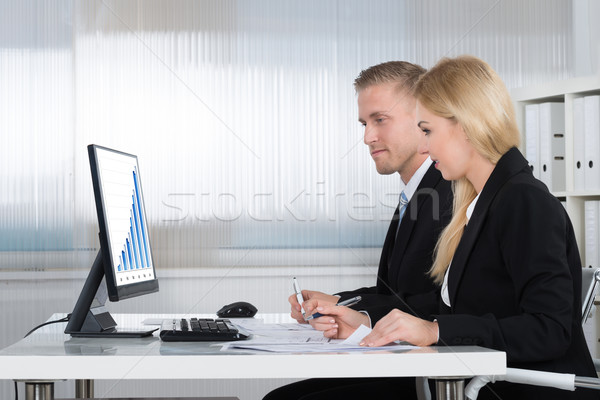 Business People Analyzing Graph On Computer Screen In Office Stock photo © AndreyPopov