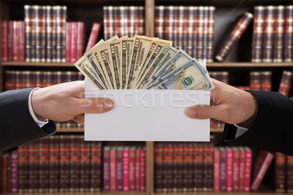 Man Hands Passing Bribe In Envelope Stock photo © AndreyPopov