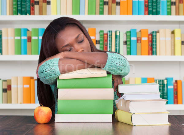 Tired University Student Sleeping On Books In Library Stock photo © AndreyPopov