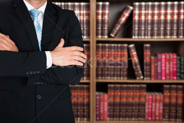 Midsection Of Lawyer With Arms Crossed Stock photo © AndreyPopov