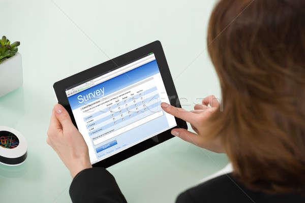 Businesswoman Filling Online Survey Form Stock photo © AndreyPopov