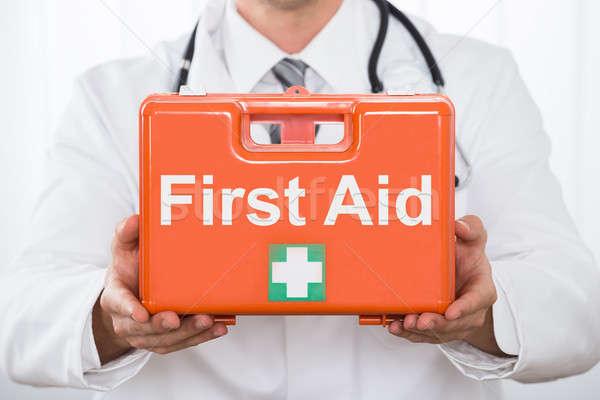 Médico mano primeros auxilios cuadro Foto stock © AndreyPopov