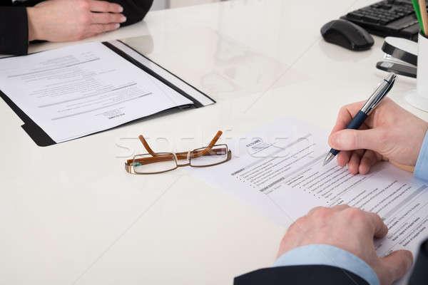 üzletember tart toll önéletrajz közelkép iroda Stock fotó © AndreyPopov