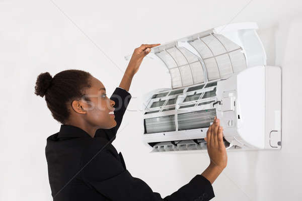 Businesswoman Checking Air Conditioner Stock photo © AndreyPopov