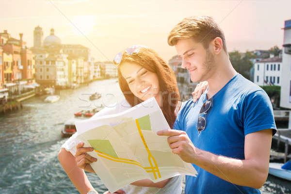 Smiling Couple With Map In Venice Stock photo © AndreyPopov