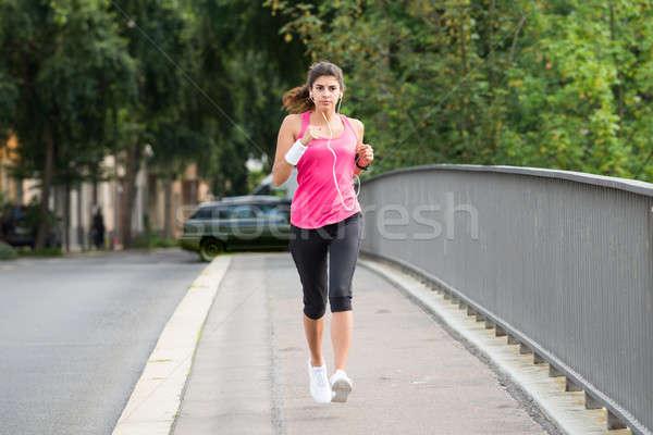 Athlete Woman Running On Sidewalk Stock photo © AndreyPopov