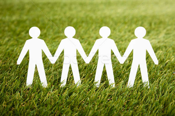 Papercut Of People Chain On Grass Stock photo © AndreyPopov