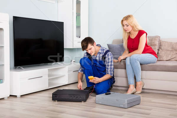 Male Technician Installing TV Set Top Box At Home Stock photo © AndreyPopov