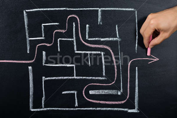 Person Solving Maze On Blackboard Stock photo © AndreyPopov