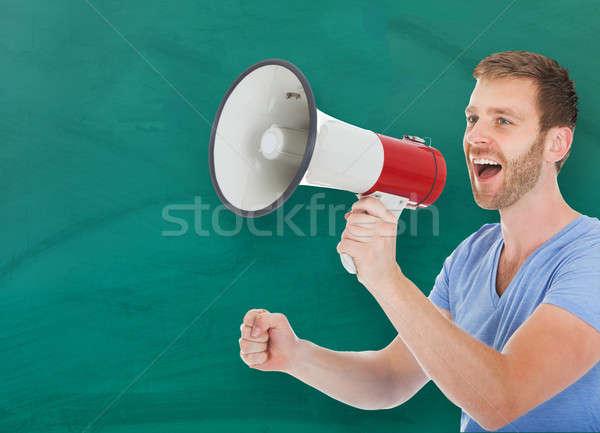 Stockfoto: Man · aankondigen · megafoon · klas · jonge · gelukkig