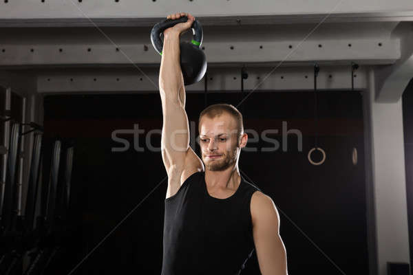 Man Doing Kettle Bell Exercise Stock photo © AndreyPopov