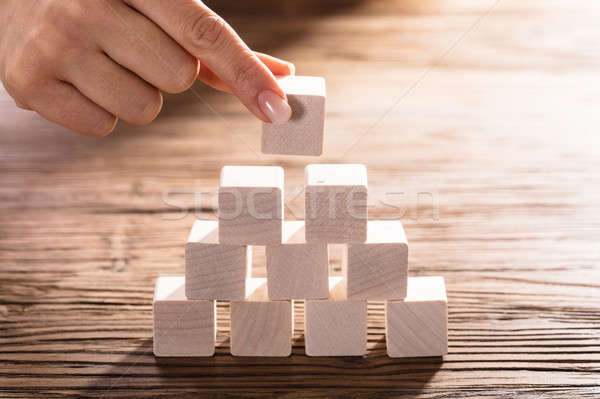 Woman Placing Block On Desk Stock photo © AndreyPopov
