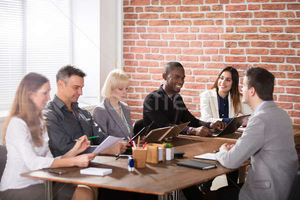 Diverse Businesspeople Discussing In The Meeting Stock photo © AndreyPopov