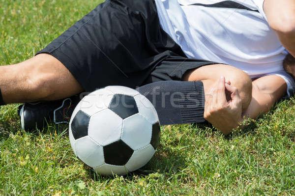 Masculino jogador de futebol sofrimento joelho ferimento Foto stock © AndreyPopov