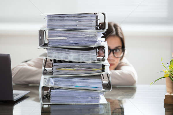 Businesswoman Hiding Behind The Folders Stack Stock photo © AndreyPopov