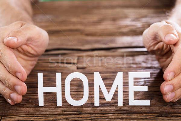 Persona home parola primo piano tavolo in legno legno Foto d'archivio © AndreyPopov