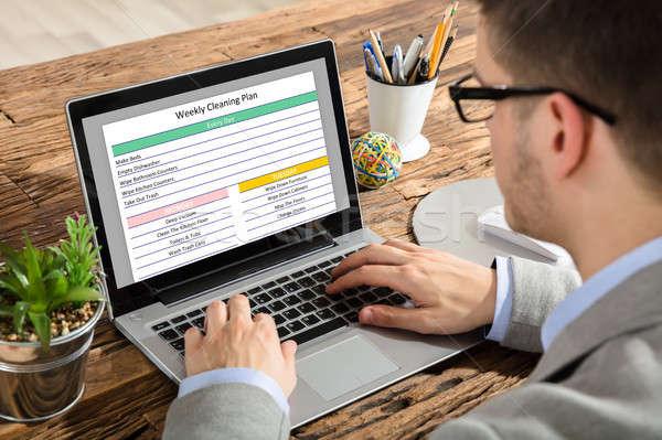 üzletember heti takarítás terv laptop közelkép Stock fotó © AndreyPopov