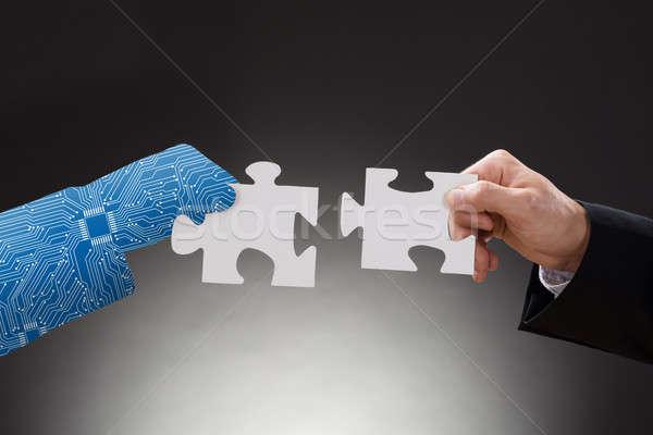 Digital mano humana hombre piezas rompecabezas Foto stock © AndreyPopov