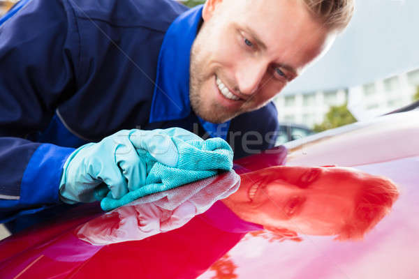 Happy Male Worker Cleaning Red Car Stock photo © AndreyPopov