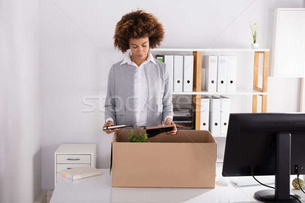 Businesswoman Packing Her Belongings In Cardboard Box Stock photo © AndreyPopov