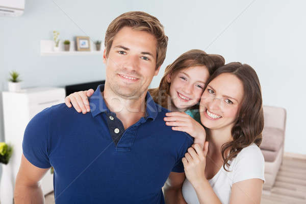 Happy Couple With Their Daughter Stock photo © AndreyPopov
