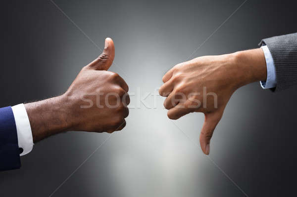 Hands Showing Thumbs Up And Thumbs Down Signs Stock photo © AndreyPopov