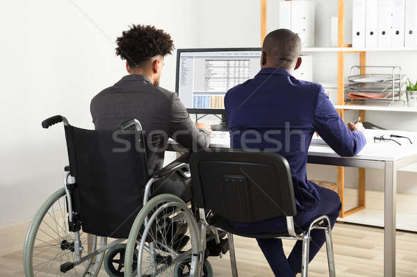 Physically Impaired Businessman With His Partner Working Stock photo © AndreyPopov