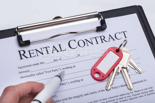 Person Filling Rental Contract Form Stock photo © AndreyPopov