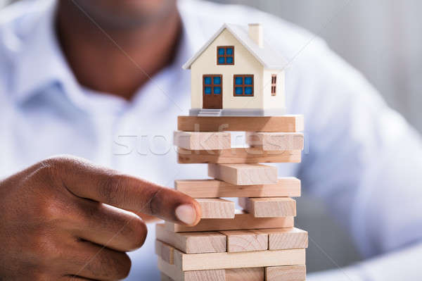 Person Holding Blocks With Miniature House Stock photo © AndreyPopov
