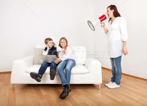Stock photo: Mom screaming at kids using megaphone