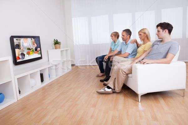 Family watching widescreen television Stock photo © AndreyPopov