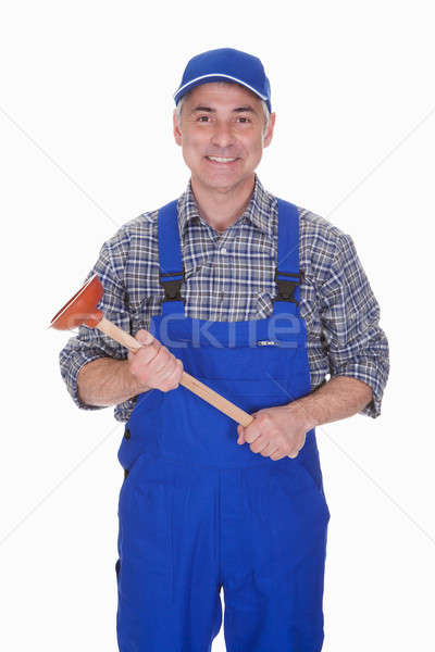 Portrait Of Male Plumber Holding Plunger Stock photo © AndreyPopov