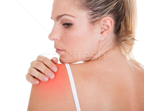 Donna dolore alla spalla isolato bianco mano Foto d'archivio © AndreyPopov