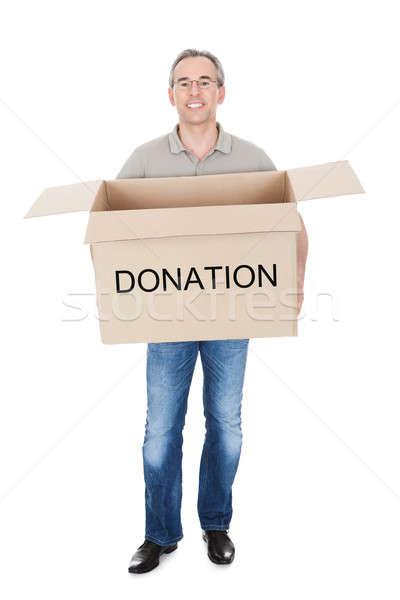 Happy man holding donation box Stock photo © AndreyPopov