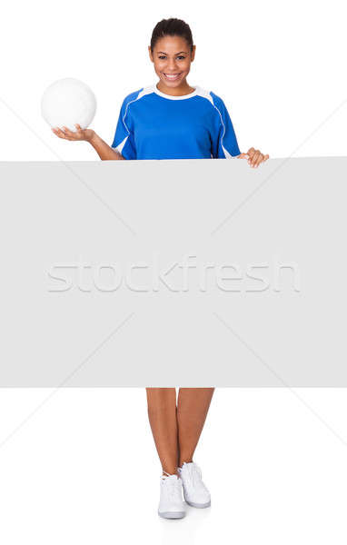 Boldog fiatal lány tart röplabda plakát izolált Stock fotó © AndreyPopov