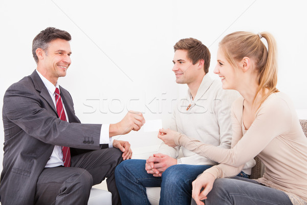 Consultant Giving Visiting Card  To Couple Stock photo © AndreyPopov