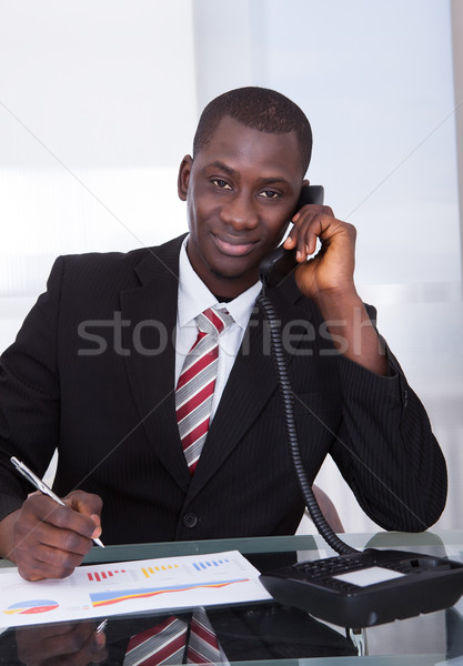 African Businessman Talking On Telephone Stock photo © AndreyPopov