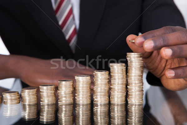Businessman Stacking Coins Stock photo © AndreyPopov