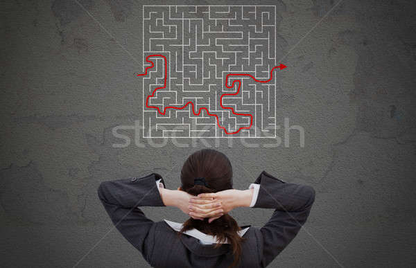 Businesswoman Looking At Solved Maze Stock photo © AndreyPopov