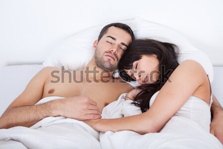 íntimo casal beijando cama jovem outro Foto stock © AndreyPopov