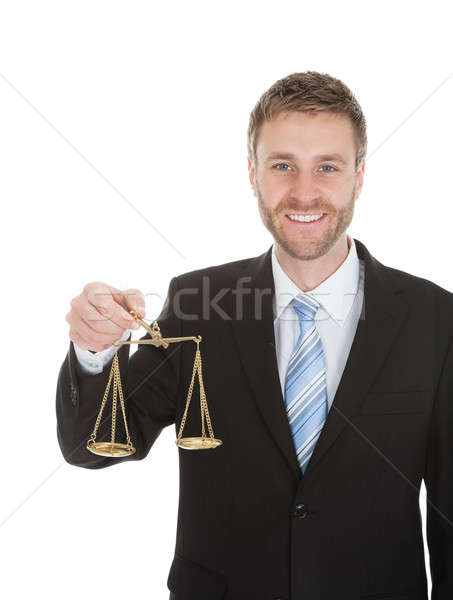 Happy Businessman Holding Weighing Scale Stock photo © AndreyPopov