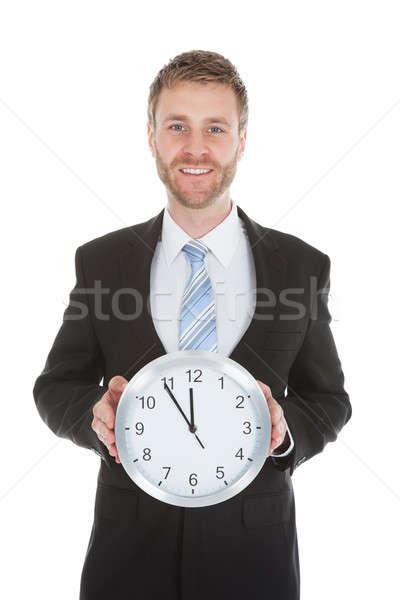 Affaires horloge portrait blanche sourire Photo stock © AndreyPopov