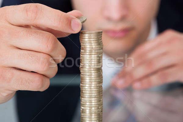 Empresário moedas secretária escritório negócio Foto stock © AndreyPopov