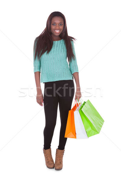 African American woman carrying shopping bags Stock photo © AndreyPopov