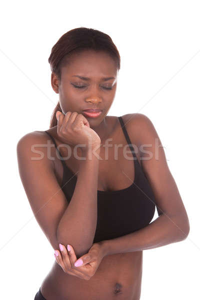 Young woman in undergarments suffering from elbow pain Stock photo © AndreyPopov