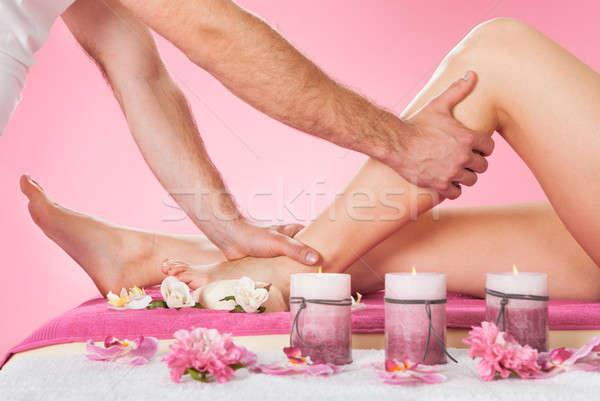 Therapist Massaging Customer's Leg At Beauty Spa Stock photo © AndreyPopov