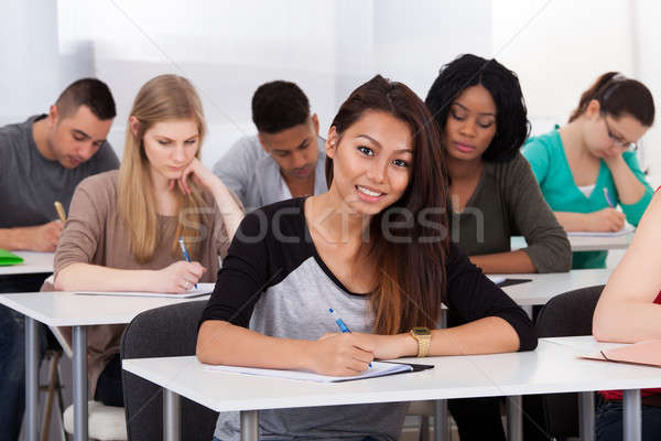 Female college student sitting at desk Stock photo © AndreyPopov