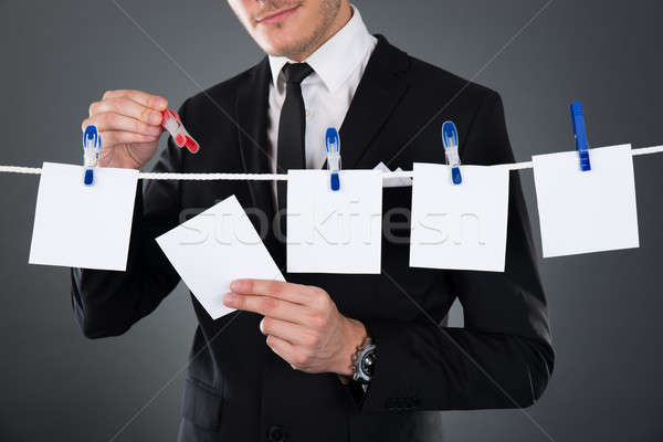 Businessman Pinning Blank Papers On Clothesline Stock photo © AndreyPopov